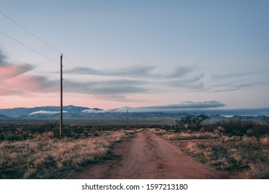 Dirt road and mountains at sunset in the desert of eastern Arizona