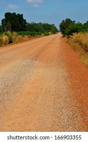 Dirt road near cassava in Thailand country