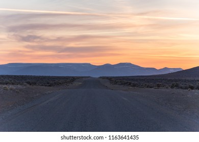 Dirt road in Nevada State, USA at sunset time