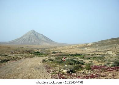 Dirt road on the arid land of Fuerteventura, Spain