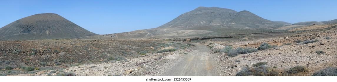 Dirt road on the desert in Fuerteventura, Spain