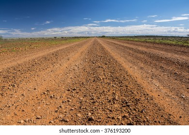 A dirt road of the Oodnadatta Track in the outback of Australia