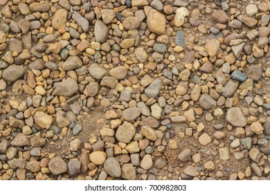 Dirt road with pebble stones background