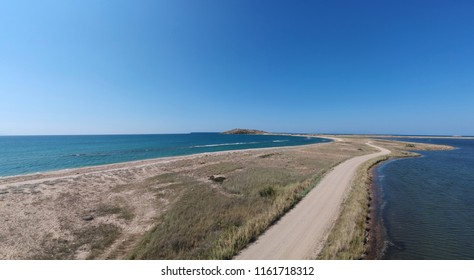 dirt road and sea 'aerial view'