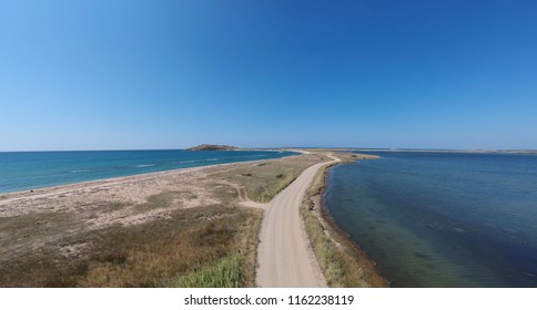 dirt road and sea - aerial view