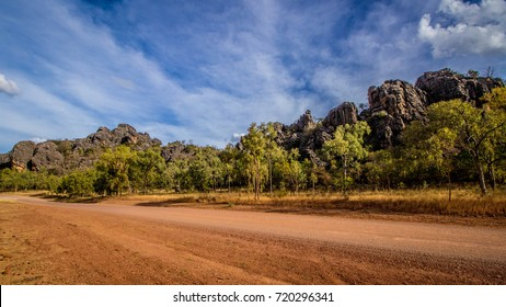 A dirt road through along side the rocks of Chillagoe