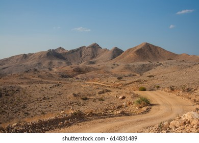 A dirt road through the hills of Wadi Kabir, near Muscat, in the Sultanate of Oman