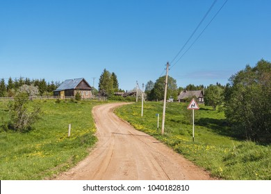 A dirt road through the village at spring