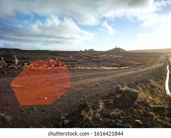 Dirt road in volcanic dramatic area in Iceland with pipeline. Backplate for offroad 4x4 4WD cars.