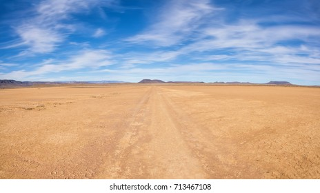 A dirt track leads through Northern Cape desert landscape, Southern Africa