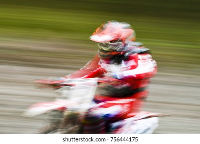 Dirtbike rider during a motocross event speeding down the track