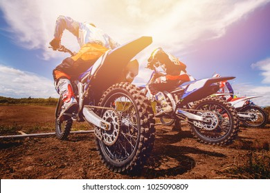 Dirtbike. Team Motocross on bike motorcycle is start road.