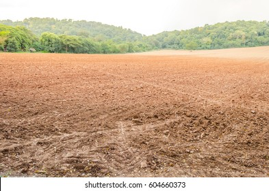Dirtous land area with mountains behind.