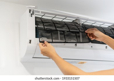Dirty air conditioner filter need cleaning. Air conditioner service, repair and clean equipment. - Shutterstock ID 1933151507