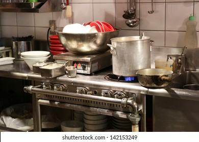 Dirty asian kitchen with unwashed noodle bowls