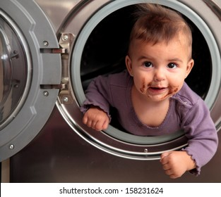 dirty baby inside a washer