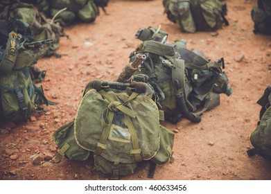 Dirty backpacks of soldiers on the ground.