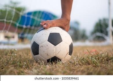 dirty bear foot on old fotball