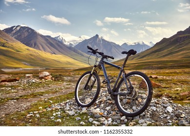 Dirty bike for cross country riding and beautiful landscape of mountain valley. Extreme riding and travel concept.