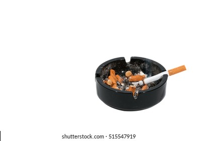 Dirty black ceramic ashtray with a cigarette full of smoked cigarettes Isolated on a white background.