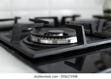 Dirty black glass kitchen stove in home kitchen.