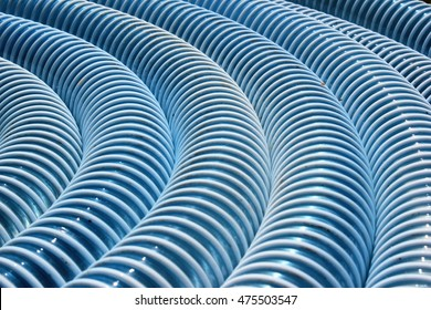 Dirty blue corrugated plastic hose as background