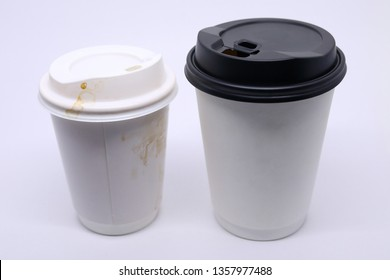 dirty brown stain on take away cup for hot coffee drink, paper mug on white background