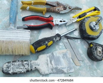 Dirty builder tools on grunge background