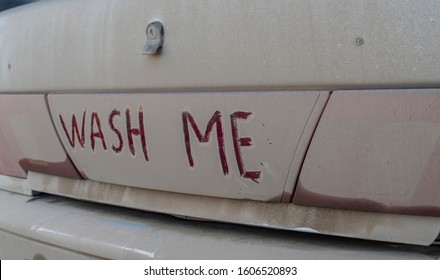 dirty car in bad weather after impassability on it an inscription asking to wash it