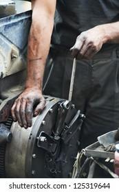 dirty car mechanic hands examining car automobile at repair service station