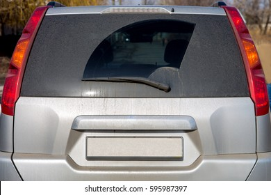 Dirty car view of glass of a rear view and boot lid.