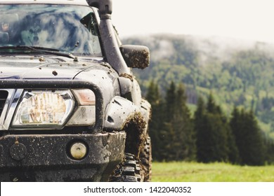 Dirty cars and wheels in the mountains. Swamp on the tires. Trips offroad across Ukraine. View of the Carpathian Mountains.