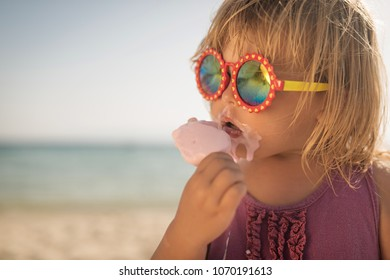 Dirty caucasian kid eat icecream on summer holiday
