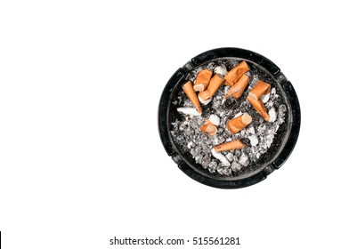 Dirty ceramic black ashtray full of cigarette butts Isolated on a white background view from above.