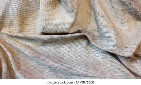 Dirty cloth. Rough dirty cloth. Fabric surface. Abstract background. Folds of matter