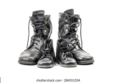 Dirty combat boots for adult and kid isolated on white background with clipping path