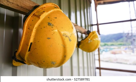 dirty construction safety helmet hanging on the wall.safety conceptual