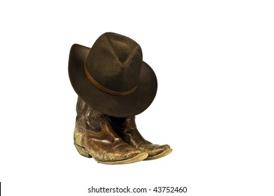 d65cda7f08f dirty cowboy boots and hat isolated