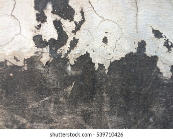 Dirty dark cement crack wall texture and background