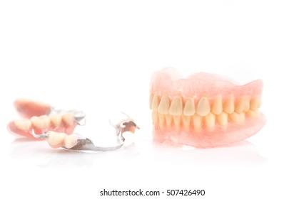 Dirty dentures,Tartar on full dentures and partial dentures on white background