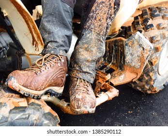 Dirty dirt boots on quadricycle