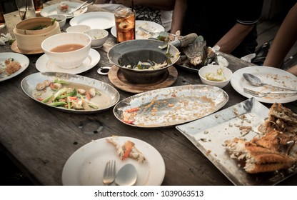 Dirty dish with food scraps on a table