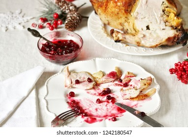 dirty dishes in the Christmas after eating turkey with cranberry sauce. leftover food after the holiday.dirty dishes after christmas. holiday leftovers