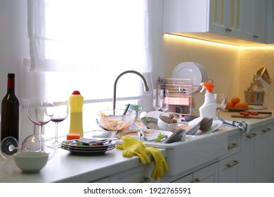 Dirty dishes in kitchen after new year party