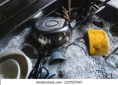 dirty dishes in the kitchen sink at home