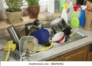 Dirty dishes in the sink after family celebrations. Home cleaning the kitchen.