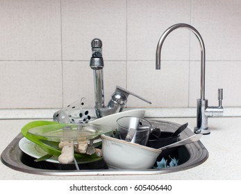 A lot of dirty dishes in the sink in the kitchen