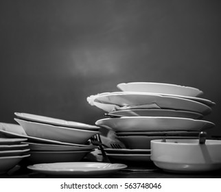 Dirty dishes stacked after lunch.