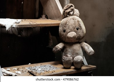 dirty doll on stair in destroyed house
