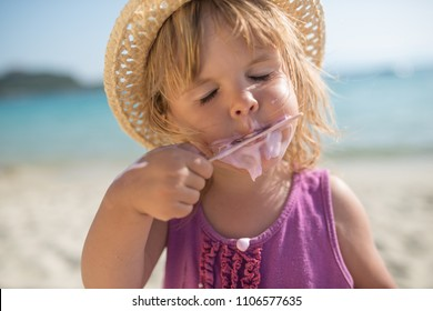 Dirty face of ice cream, summer portrait of little girl